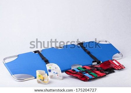 Stretcher, back protecting belts and bands - stock photo
