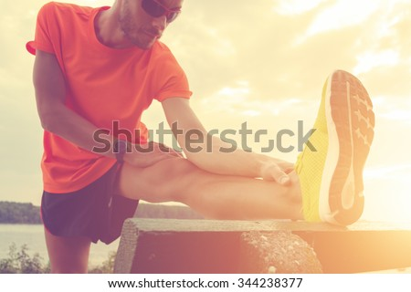 Stretching after jogging. - stock photo