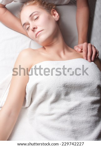 stretching ostheopathy procedure in the neck - stock photo