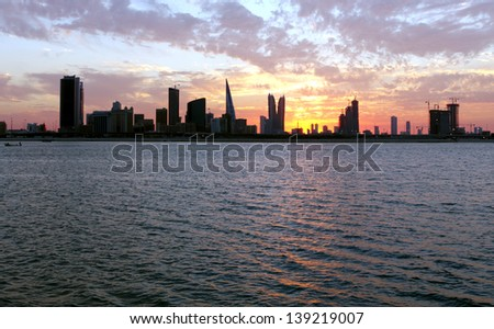 Stretching sea and Bahrain skyline during sunset - stock photo