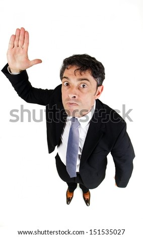 Strict businessman menacing with his hands isolated on white background - stock photo