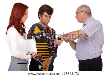 Strict father with belt punishes his young son and daughter showing watch, isolated on white background - stock photo