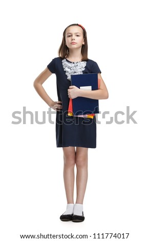 Strict schoolgirl carries her books, isolated, white background - stock photo