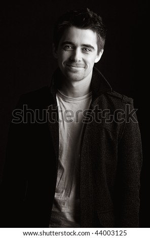 Striking Portrait Shot of a Handsome Dark Haired Male Smiling - stock photo