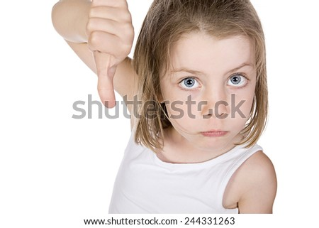 Striking Shot of a Pretty Young Girl with her Thumb Down - stock photo