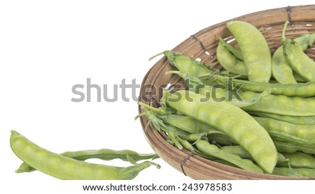 String bean in a basket isolated on a white background. - stock photo