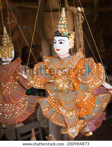 String puppet Burmese (Myanmar) tradition dolls are hanging in souvenir shop - stock photo