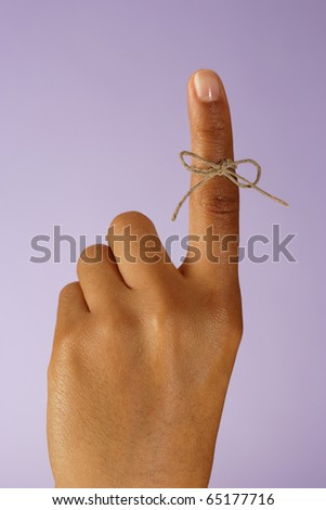 String tied around finger - stock photo