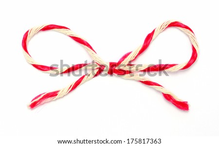 String tied in a bow on white  - stock photo