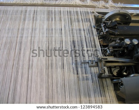 Strings in a weaving hand loom - All strings attached - Textile abstract - stock photo