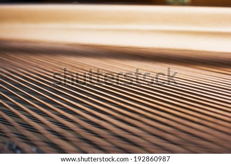 Strings inside of a concert piano - stock photo