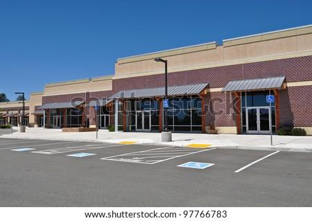 Strip Mall Shopping Center Parking Lot - stock photo
