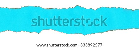 Strip of blue paper with burnt edges. Studio shot close-up on a white background. Isolated. - stock photo