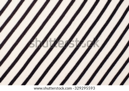 Striped blue and white textile pattern as a background. Close up on diagonal stripes material texture fabric. - stock photo