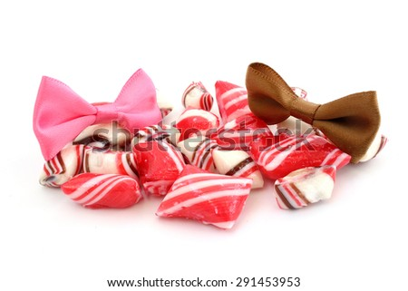 Striped candy and ribbons of different colors - stock photo