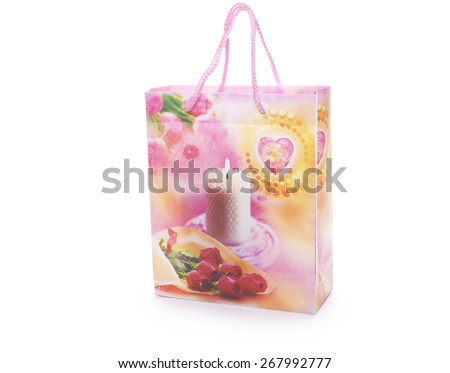 Striped gift bag isolated on the white background - stock photo
