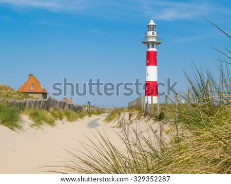 Striped Lighthouse on the coast of the North Sea, Belgium - stock photo