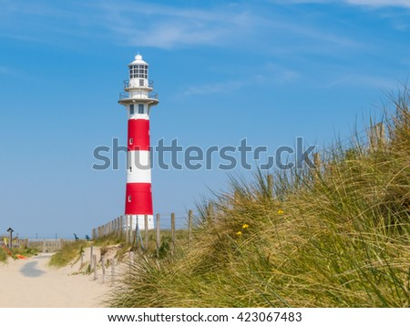 Striped Lighthouse Vierboete on the coast of the North Sea, Belgium - stock photo
