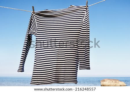 Striped shirt on the sea background - stock photo