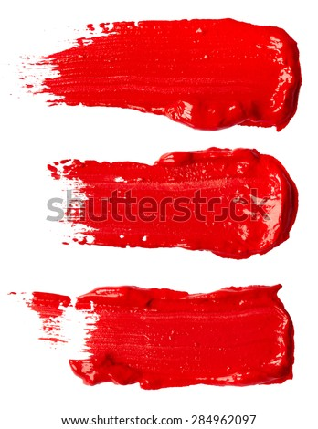 Stripes of red paint isolated on white background - stock photo