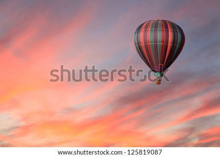 Stripped Hot Air Balloon in Pink Sky - stock photo