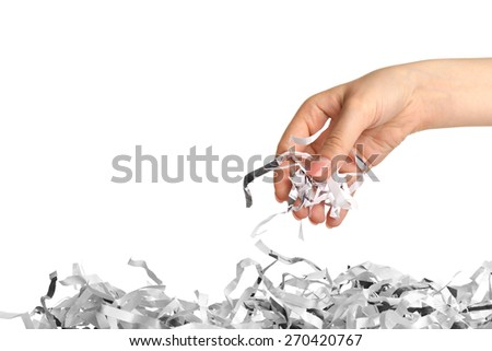 Strips of destroyed paper from shredder in female hand isolated on white - stock photo