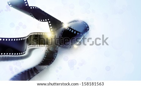 Strips of film on blue tone background - stock photo