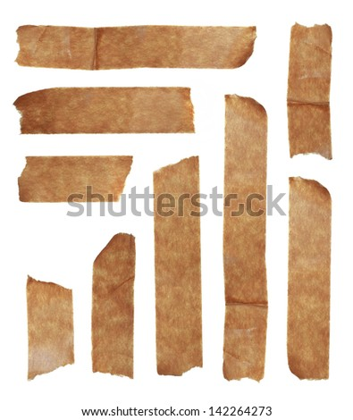 Strips of masking old tape isolated on white - stock photo