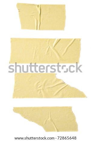 Strips of masking tape isolated on white background. - stock photo