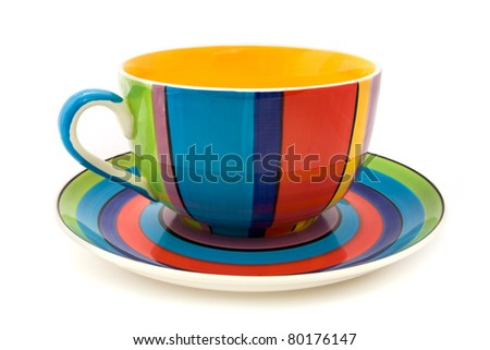 Stripy cup and saucer isolated on a white background - stock photo