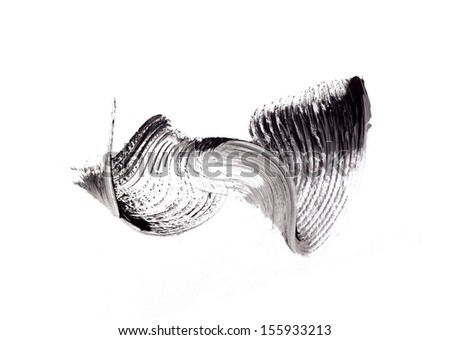 Stroke (sample) of black mascara, isolated on white - stock photo