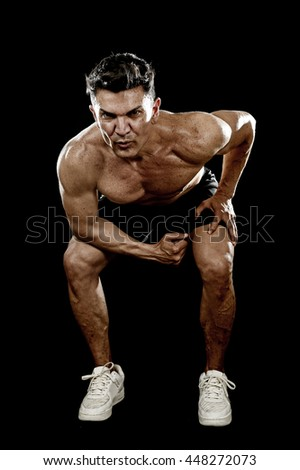 strong and fit man with ripped body muscles doing squat exercises showing defined shoulders and biceps in naked torso isolated on black background in sport condition and training concept - stock photo