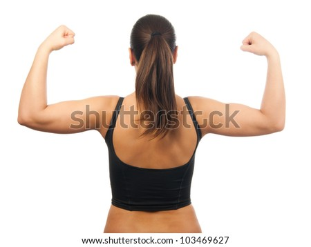 Strong and muscular young woman showing her muscles isolated on white. - stock photo