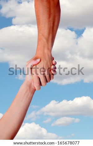 Strong arm assisting on a sky with clouds background  - stock photo