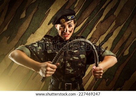 Strong army soldier woman - stock photo