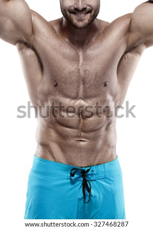 Strong Athletic Man Fitness Model Torso showing abdominal muscles without fat isolated over white background - stock photo