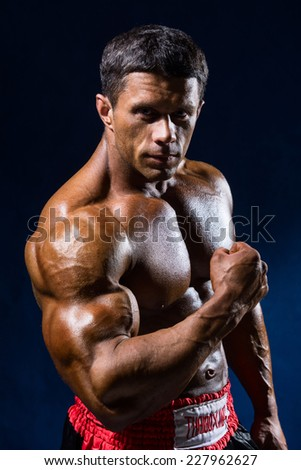 Strong Athletic Man Fitness Model Torso thai boxer showing big muscles. - stock photo