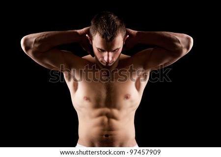 strong athletic muscle man, bodybuilder isolated on black background - stock photo