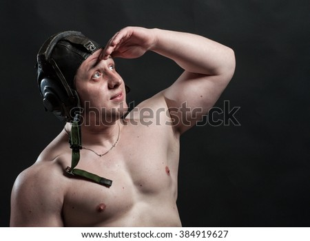 strong brutal man peering forward into headset - stock photo
