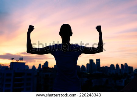 Strong confident woman in the city - stock photo