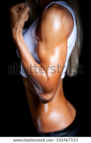Strong female biceps - stock photo