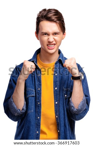 Strong fighter. Confident excited young man holding fists. Isolated on white. - stock photo