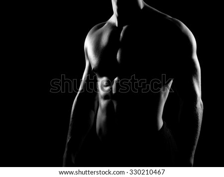 Strong, fit and sporty bodybuilder man in grayscale. - stock photo