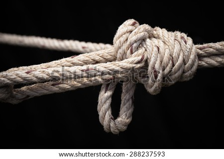 Strong knot tied by a rope. - stock photo