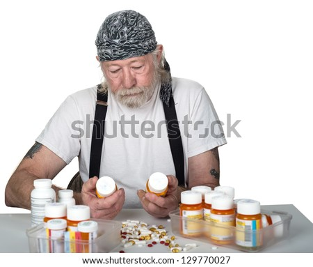 Strong Man holding prescription bottles with pills on table isolated on white - stock photo