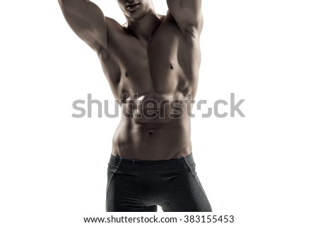 Strong man showing perfect body, abs and chest. Close-up - stock photo