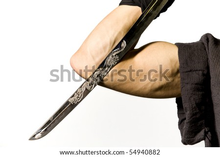 strong muscular arm holding a katana or samurai sword against a white background - stock photo