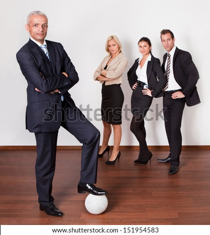 Strong professional competitive business team of four people - stock photo