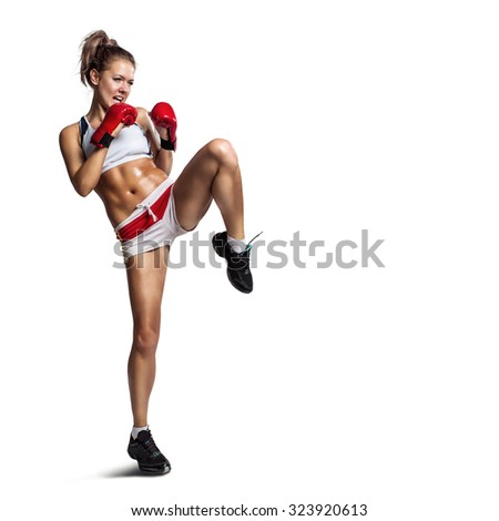 Strong sportswoman in boxing gloves prepared higt kick. Isolated on white background - stock photo