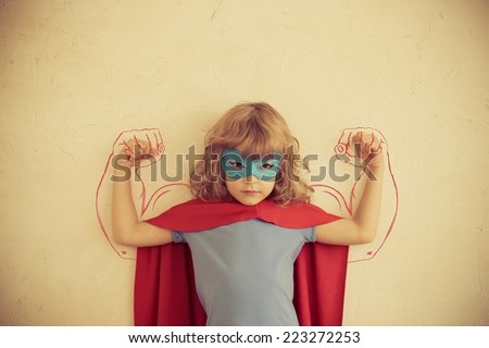 Strong superhero child. kid with drawn muscles. Girl power and feminism concept - stock photo